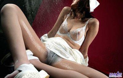 Beautiful Asian model babe Wakako Hujimori is exciting by hotly posing in sexy white stockings