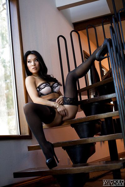 Hot Asian pornstar Asa Akira modeling solo in black stockings and high heels