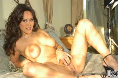 The naked Asian girl Asia Carrera is playing with her big boobs on camera