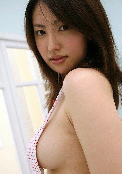 Dark haired Asian hottie Takako Kitahara enjoys in showing her butt on camera