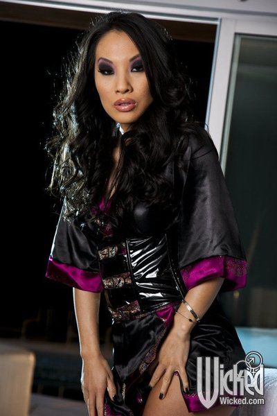 Busty Asian in high heeled leather boots Asa Akira shakes the melons and shows nub nudity