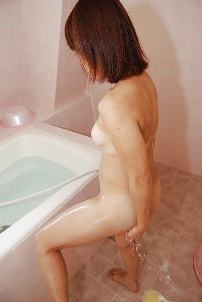 Cute asian milf Yumi showing and washing that hairy tasty pussy