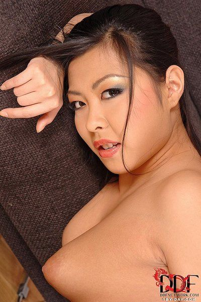 Gorgeous Asian cutie Courtney Sweet slips out of her bikini to make some juicy softcore porn