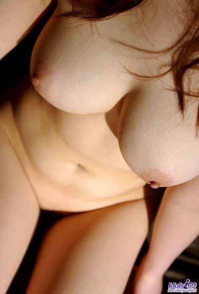 Lewd big titted chick Sumire Aida is flashing the beautiful bushy pussy up skirt