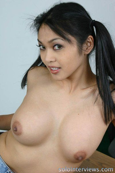 Juicy titted asian schoolgirl Mika Tan takes off her blue skirt and white panties