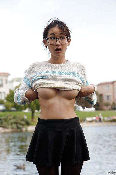 Adorable Asian babe Saki Kishima showcasing her amazing curves outdoors