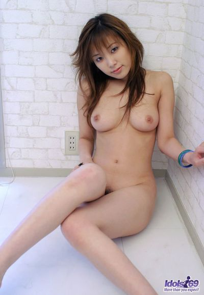 Slender sexy Asian babe Yua Idols is bending her flexible body in sexy hot poses and demonstrating her pussy