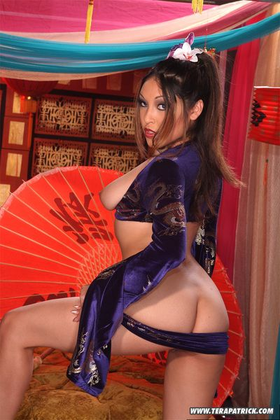 Exotic high heeled asian Nautica Thorn  poses with red umbrella and shows her private parts