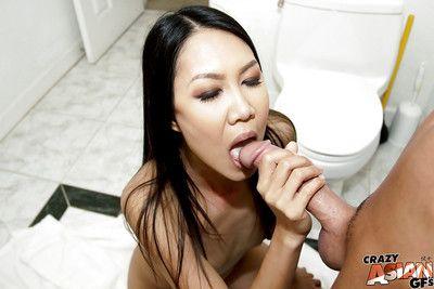 Amateur Asian brunette Tala Basi unbuttons trousers and sucks shaft