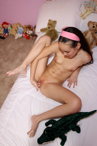 Cute Asian teen Amai Liu pinching the nipples and shyly showing the cunt