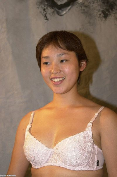 Short haired amateur Ai disrobing to exhibit hairy pussy in the nude