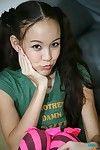 Petite exotic girl Amai Liu with tiny tits strips before giving wet handjob