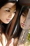Asian girlie Ran Asakawa is in the white lingerie and also all naked before camera