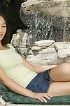 The exciting softcore session with Asian chick Evelyn Lin stretching outdoor