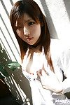 Doll face asian teen with tiny titties stripping off her clothes