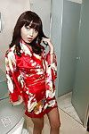 Asian babe Marica Hase demonstrates her tiny tits while masturbating