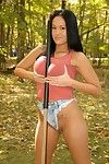 Big meloned exotic babe Dee Lilly stripteases and exposes her smooth snatch outdoor.