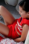 Oriental chick Sable Simms in red uniform spreads her exotic pussy open with no shame