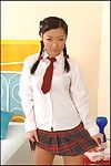 Spicy Asian teen Courtney strips her school uniform and fingerfucks and dildos her tight holes.