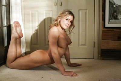 Curvaceous blonde bombshell with a big arse shows off her hot body