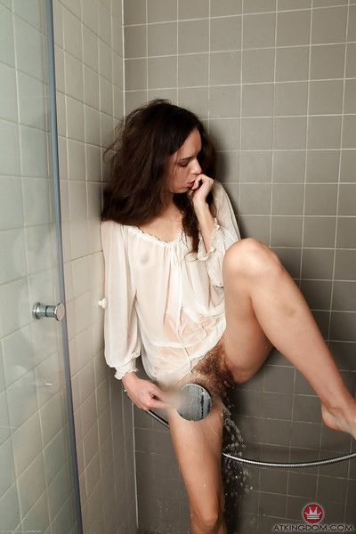 Wiry brunette doll amplifying wet and hairy uterus in washroom
