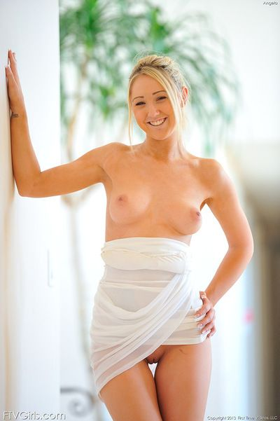 Blonde Angela plays corporeal and gently reveals her bare forms