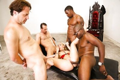 Golden-haired slut sucks big swarthy cock and gets screwed rough in interracial gangbang