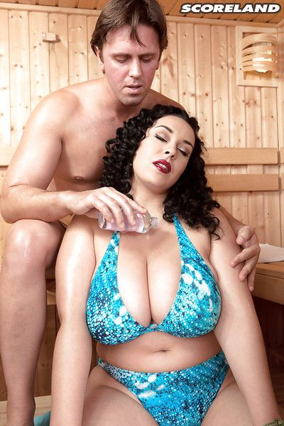 Large dark hair Anastasia Lux loosing weighty tits from bikini for sex in sauna