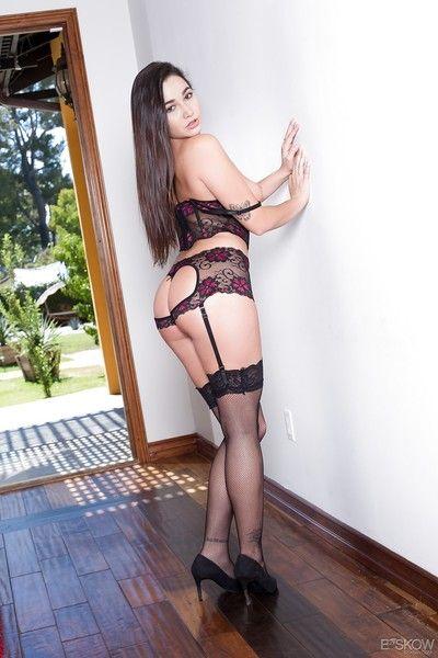 Brunette solo girl Karlee Grey exposing big regular tits and trimmed bush