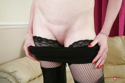 Skinny grown lady Scarlet striking hot non nude location in stripper boots