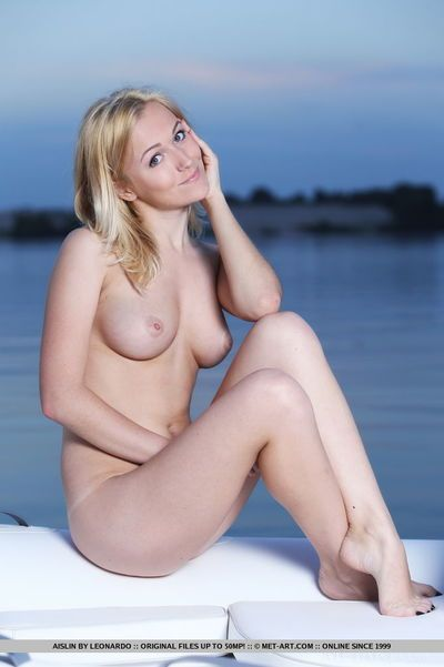 Golden-haired glamour babe exposing marvelous infant tits and trimmed cunt outdoors