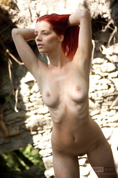 Redhead pretty Piper Fawn with finest marangos positions in her uncovered skin in the forest
