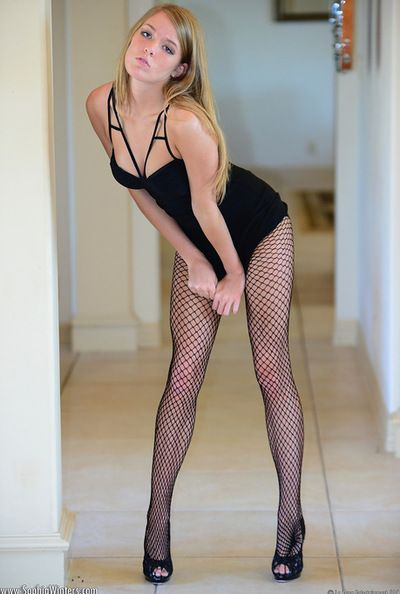 Busty Sophia Winters likes posing in her sexy fishnet during hot solo action