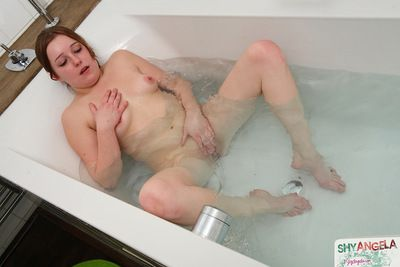 Physical juvenile likes playing with her warm cunt even as in the tub