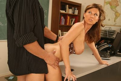 The breasty milf Devon Lee is wildly smoking the stud's piston in the college