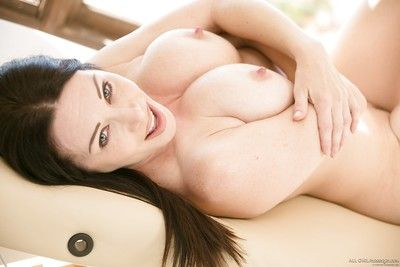 Busty brown hair chick Rayveness exposing her large all typical breasts