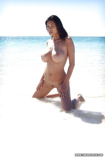Biggest busted dark hair vixen striptease off her pink panties on the beach