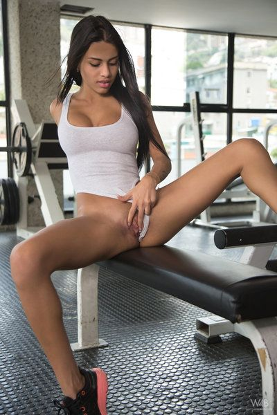 Latin cutie illustration Denisse Gomez undressing in gym for fingering of lewd pussy