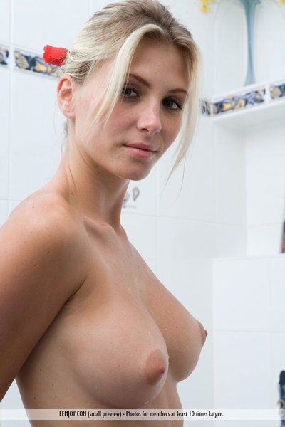 Well endowed blonde girl Heather Hawt enjoys a steaming hot bubble bath