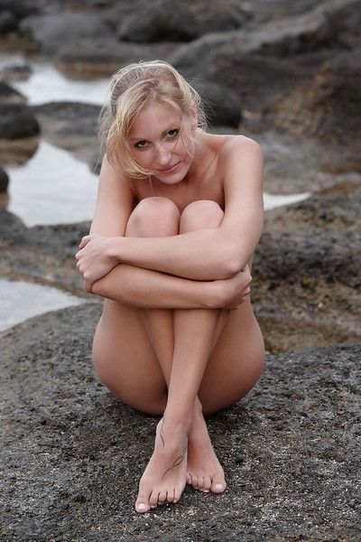 Young shy pornstar dear is showing her stylish body outdoor