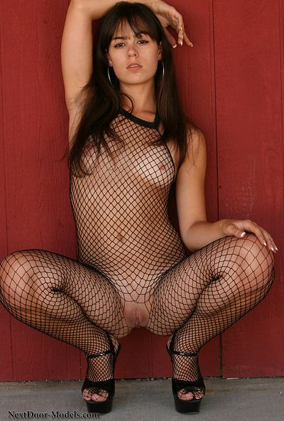 Hungry Abby Brooks looks amazing while posing in her fishnet costume