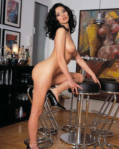 Black haired european teaser Lara Stevens positions in sexy lingerie and naked