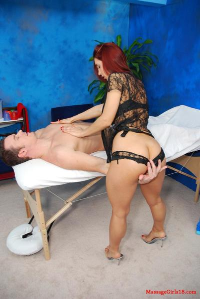 Round boobed redhead Kylee Strutt stripped off undressed to ride a tough dicked man at the massage studio