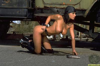 Gun babe Veronica Vanoza in brown bandanna and boots displays her mammoth oiled boobies