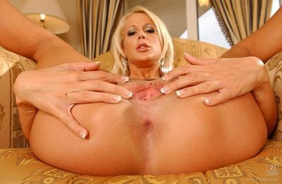 Pretty blond Dorina shows off her pink hole after striptease and fingering