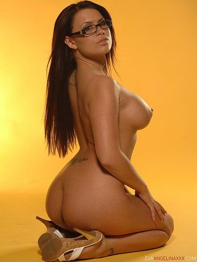 Four-eyed pornstar Eva Angelina with skillful big boobs pose sin undersize bikini and bare
