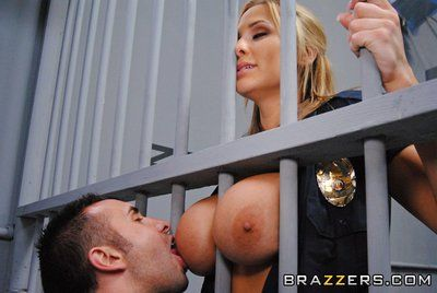 Biggest titted prison guard Alanah Rae takes off her uniform and pink underclothes to be fucked