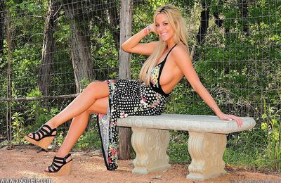 Golden-haired arousing babe poses in outdoor and masturbates her shaved cunt