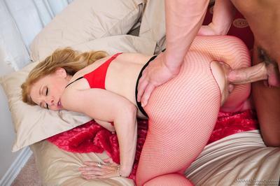 Seducing milf in fishnet pantyhose Nina Hartley amplifies legs letting guy fuck her nub during hole