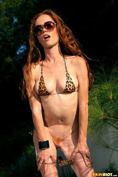 Feel like haired slight redhead Heather Carolin in sunglasses removes her bikini outdoors